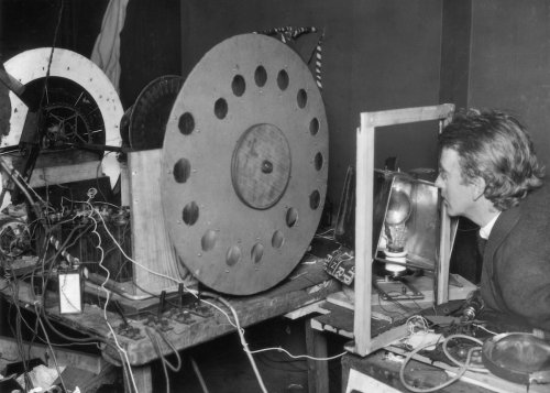 John Logie Baird and his disc scanning machine.